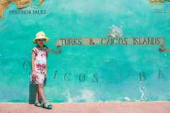 Little girl near big map of Caribbean island Turks Stock Photos