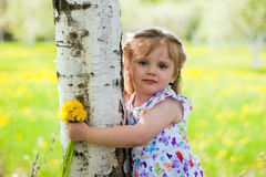 Little girl near birch Royalty Free Stock Images
