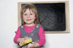 Little girl near blackboard Royalty Free Stock Photo