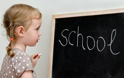 Little girl near blackboard Stock Image