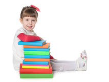 Little girl near books Royalty Free Stock Photos