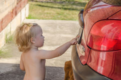 Little girl near the car Royalty Free Stock Photography