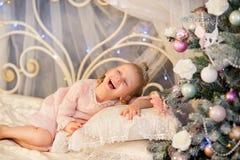 The little girl near a Christmas fir-tree Royalty Free Stock Photos