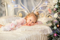 The little girl near a Christmas fir-tree Royalty Free Stock Images