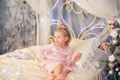 The little girl near a Christmas fir-tree Royalty Free Stock Photo