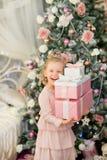 The little girl near a Christmas fir-tree Stock Photography