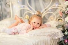 The little girl near a Christmas fir-tree Stock Images
