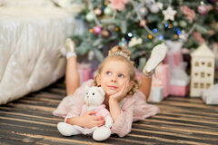 The little girl near a Christmas fir-tree Stock Images