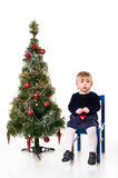 Little girl near the Christmas tree Stock Images