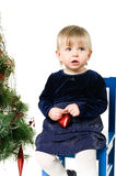 Little girl near the Christmas tree Stock Photography