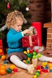 Little girl near Christmas tree Royalty Free Stock Photos