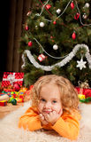 Little girl near Christmas tree Stock Photo