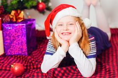 Little girl near the Christmas tree with gifts Royalty Free Stock Photo