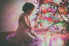 Little girl near the Christmas tree stock photo