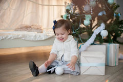 Little girl near Christmas tree with presents rejoices holiday, new year, decorations, gift, box, holiday, lifestyle Stock Images