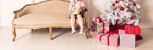 Little girl near Christmas tree Stock Image
