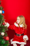 Little girl near the Christmas tree Royalty Free Stock Photography