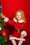 Little girl near the Christmas tree Stock Image