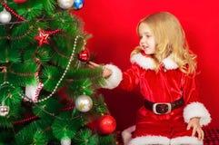 Little girl near the Christmas tree Stock Photography
