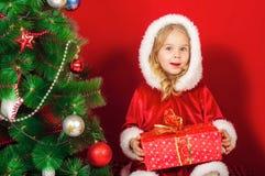 Little girl near the Christmas tree Stock Images