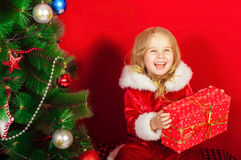 Little girl near the Christmas tree Royalty Free Stock Image