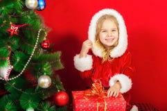 Little girl near the Christmas tree Royalty Free Stock Photo