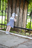 Little girl near fence Royalty Free Stock Images