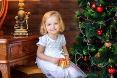 Little girl near festive christmas tree stock image