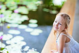 Little girl near lily pond Royalty Free Stock Images