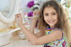 Little girl near the mirror Royalty Free Stock Images