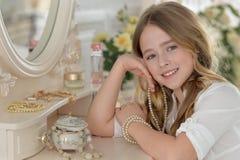 Little girl near the mirror Stock Image