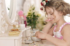 Little girl near the mirror Stock Photography