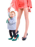 Little girl near mother's legs Royalty Free Stock Photography