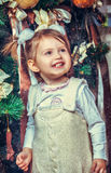 Little girl near the new year tree Royalty Free Stock Photo