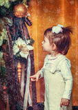 Little girl near the new year tree Stock Photo