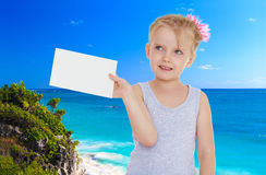 Little girl near the ocean Stock Photos