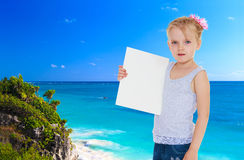 Little girl near the ocean Royalty Free Stock Images