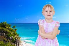 Little girl near the ocean Royalty Free Stock Photos