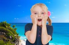Little girl near the ocean Stock Images