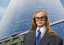 Little girl near office in funny spectacles Royalty Free Stock Image
