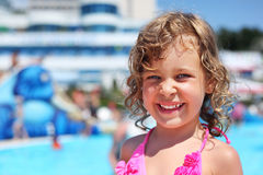 Little girl near pool in aquapark Royalty Free Stock Image