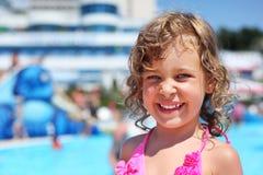 Little girl near pool in aquapark royalty free stock image