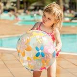 Little  girl near the pool Stock Photo