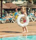 Little  girl near the pool Stock Photos