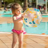 Little  girl near the pool Royalty Free Stock Photo