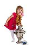 Little girl near the samovar Stock Photo