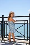 Little girl near the sea stock photos