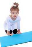 Little girl near a sports mat Stock Photo