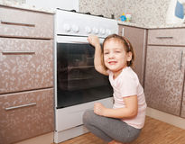 Little girl  near  stove. Royalty Free Stock Images