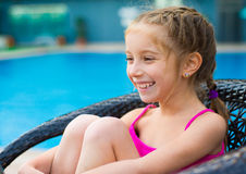 Little girl near sweaming pool Royalty Free Stock Photos